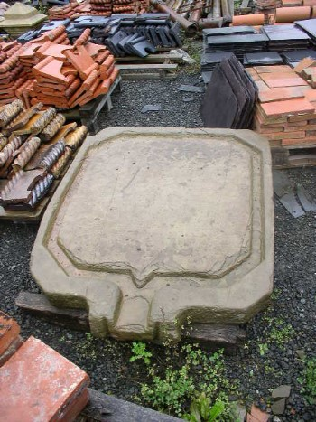 Square cider press stone base with protruding spout from the UK